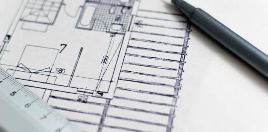 immagine in bianco e nero con progetto di una casa